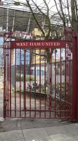 "A single ""West Ham United"" gate forming part of The John Lyall Gates. In December 2009, the gates were originally constructed after West Ham used the ᆪ25,000 fee from the 1956 transfer of free-scoring winger Harry Hooper to buy the land that now makes up the main Boleyn Ground car park, with the new gates built at its entrance. In December 2009, the gates were renamed The John Lyall Gates in honour of the Hammersメ legendary manager who had died three years previous, at the age of 66."