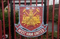 A claret and blue painted iron West Ham United crest, originally sited on the fence to one side of The John Lyall Gates on Green Street.