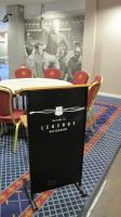 A West Ham United crested 'Welcome to the Legends Restaurant' floor standing lectern from the Betway stand Legends lounge.