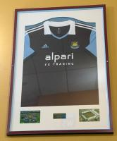A framed 'West Ham United Football Club' Alpari FX Trading sponsored home shirt season 2013-14 signed by the squad. Originally displayed in the Betway stand main central staircase.