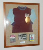A framed West Ham United home shirt, West Ham United 1 Blackburn 1, 7th November 1964, shirt number 3 worn by Martin Peters. West Ham's goal coming from John Sissons. Originally displayed in the Betway stand main central staircase.
