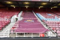 The 'West Ham United crested' and 'We Are Moore Than a Football Club' PVC banner's used on the lower Sir Trevor Brooking stand seating area as a seating divider.