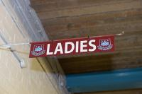 A metal 'West Ham United Ladies' toilet sign from the East Stand lower concourse.