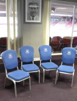 Four sky blue upholstered chairs with embroidered West Ham United crest. (John Lyall picture in background not included).