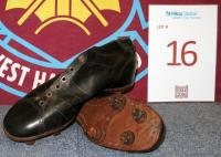 A pair of size 9 black leather vintage football boots.