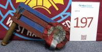 "A claret and blue painted F.A. Cup wooden football rattle, understood to be from the 1923 F.A.Cup Final. Bolton Wanderers 2 West Ham United 0, 28th April 1923, the first ever F A Cup Final at Wembley Stadium, referred to as ""The White Horse final"". Bolton Wanderers winning 2-0 with goals coming from David Jack and Jack Smith either side of half time."