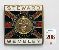 A Wembley World Championship Jules Rimet Cup England 1966 Stewards' metal and enamel badge. England beating West Germany 4-2 (after extra time) in the final at Wembley on 30th July 1966 with goals from Martin Peters and a Geoff Hurst hat-trick, Helmut Haller and Wolfgang Weber scoring in reply for West Germany.