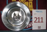 A metal dish inscribed with image of Lausanne La Cathedral. European Cup Winners' Cup Quarter Final 1st Leg, Lausanne Sport v West Ham United, Stade Olympique de la Pontaise, 16th March 1965. West Ham winning the 1st Leg 2-1 with goals from Brian Dear and Johnny Byrne. The 2nd Leg finished 4-3 with goals coming from Tacchella (Og) Brian Dear (2) and Martin Peters. West Ham going through to the Semi-Final 6-4 on aggregate.