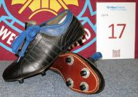 A pair of black with blue trim and blue laces leather vintage football boots (silver signature printed to inner tongue).