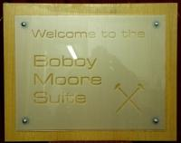 A ムWelcome to theᅠ Bobby Moore Suiteメ sign on backboard. An original sign from the Old Bobby Moore Suite (Now the Greenwood & Lyall Lounge) in the Bobby Moore stand