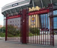 "A set of ""West Ham United Football Club"" double gates forming part of The John Lyall Gates. In December 2009, The gates were originally constructed after West Ham used the ᆪ25,000 fee from the 1956 transfer of free-scoring winger Harry Hooper to buy the land that now makes up the main Boleyn Ground car park, with the new gates built at its entrance. In December 2009, the gates were renamed The John Lyall Gates in honour of the Hammersメ legendary manager who had died three years previously"