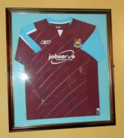 A framed 'West Ham United Football Club' Jobserve sponsored home shirt season 2005-07 signed by the squad. Originally displayed in the Betway stand main central staircase.