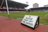 The floor standing 'West Ham United Please Keep Off The Grass' sign, used opposite entrance to players tunnel.