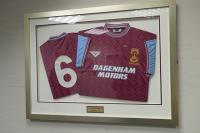 Two framed West Ham United Football Club shirts from the West Ham United Football Club v FA Premier League XII Bobby Moore memorial match dated 7th March 1994. Originally displayed in the Greenwood and Lyall Lounge Reception. A year after Bobby Moore's passing on March 1994, West Ham hosted an all-star premiership XI composed of players from all 22 top-flight clubs in memory of the late, great Hammer and England captain. The match also marked the official opening of the New Bobby Moore Stand wit