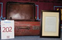 A leather suitcase No. W.H.U.F.C 34. This leather case was used by individual players for their playing kit from the early part of the 20th century. Players were responsible for carrying their own boots and rubber shin pads which were much thicker than those worn by players now. The case is very heavy even without kit and has a separate compartment for boots with framed Leather Case description signed by Eddie Chapman.A leather suitcase No. W.H.U.F.C 34. This leather case was used by individual