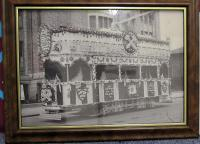 "A black and white framed photograph of a Tram decorated to celebrate West Ham United reaching the first FA Cup Final at Wembley in 1923. Bolton Wanderers 2 West Ham United 0, 28th April 1923, the first ever F A Cup Final at Wembley Stadium, referred to as ""The White Horse final"". Bolton Wanderers winning 2-0 with goals coming from David Jack and Jack Smith either side of half time."