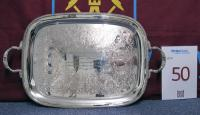 "A plated metal two-handled rounded rectangular tray, engraved with foliate scrolls and inscribed ""Presented by Newham Corporation to Martin Peters Member of the England Football Team, Winners of The World Cup, Wembley, 30th July 1966"". Presented following England beating West Germany 4-2 after extra time in the 1966 World Cup Final. Approx. 22 in. wide."
