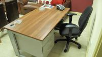 The West Ham United managers single pedestal three drawer desk with wood effect veneer desk-top and grey steel frame with offfice chair and BT Relate 2100 telephone handset from the Managers Office.
