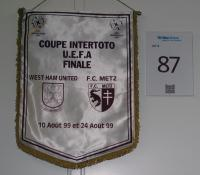 A large pennant of Coupe Intertoto U.E.F.A. Finale West Ham United v F.C. Metz 10 Aout et 24 Aout 1999. Match result 1st Leg 10 August 1999, West Ham United 0 F.C. Metz 1, Boleyn Ground, 2nd Leg 22 August 1999, F.C.Metz 1 West Ham United 3, Stade Saint-Symphorien, Metz. West Ham winning the Intertoto Cup Final 3-2 on aggregate.