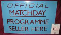 A claret and blue 'Official Matchday Programme Seller Here' sign. Originally sited on the Bobby Moore stand upper concourse.