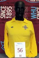 "A yellow Northern Ireland International goalkeeper's shirt with vee neck collar and embroidered cloth badge, inscribed ""Irish Football Association"". Shirt exchanged with Martin Peters during the British Championship between 1970 and 1973. The British Home Championship (also known as the Home International Championship, the Home Internationals and the British Championship) was an annual football competition contested between the United Kingdom's four national teams: England, Scotland, Wales and N"