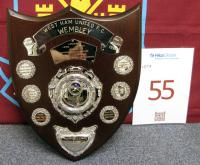 A white metal-mounted mahogany shield, engraved with West Ham United F.C. Wembley, Wembley Final May 2nd 1964, West Ham United 3 Preston North End 2, J. Standen, J. Bond. J Burkett, K. Brown, E. Bovington, B. Moore, R. Boyce, G. Hurst, P. Brabrook, J. Byrne, J. Sissons 3rd. Round West Ham 3 Charlton 0, 4th. Round Leyton O. 1 West Ham 1, Replay West Ham 3 Leyton O. 0, 5th. Round Swindon 1 West Ham 3, 6th. Round West Ham 3 Burnley 2, Semi Final West Ham 3 Man,Utd. 1, Directors - R.H. Pratt J.P (C