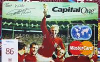 A large copy of a Capital One MasterCard with picture of 1966 World Cup Winners with trophy and autographed by Geoff Hurst.