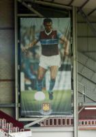 The stanchion hanging Trevor Brooking crested banner, approximately 60ft X 20ft Originally hanging in the Betway stand